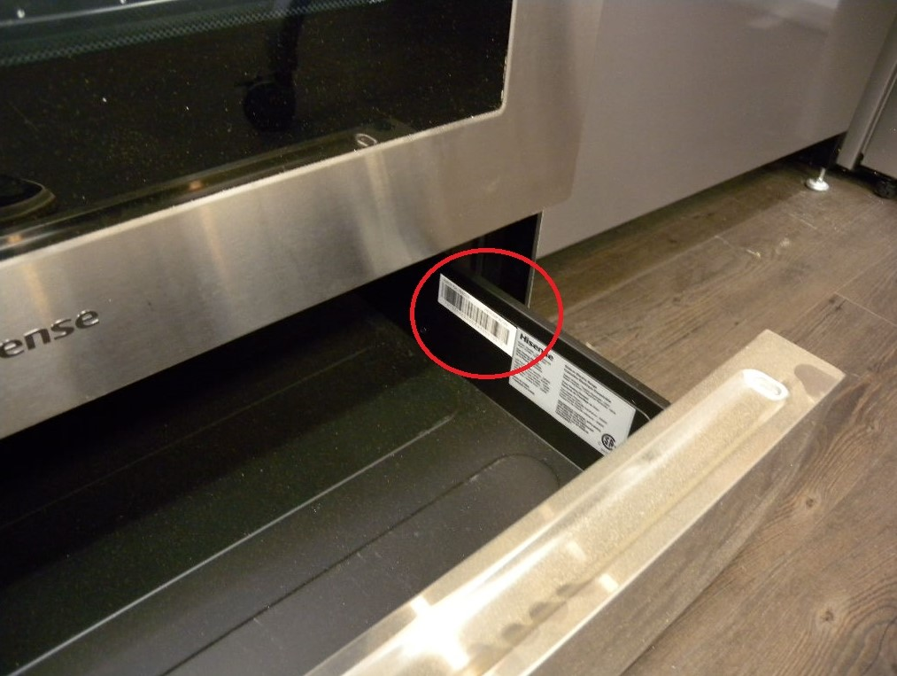 Hisense range drawer open showing white sticker and serial number